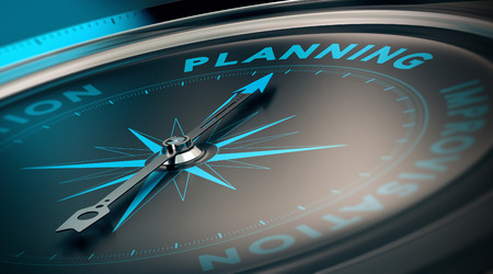 Foto de Compass with needle pointing the word planning, concept image to illustrate business plan and strategy. - Imagen libre de derechos