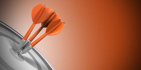 Foto de Three darts hitting the center of a target over orange background. Business success concept image. - Imagen libre de derechos