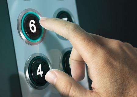 Foto de Elevator buttons with finger pressing the number six, concept of choice - Imagen libre de derechos
