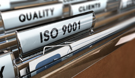 Photo pour Close up on a file tab with the word ISO 9001, focus on the main text and blur effect. Concept image for illustration of Quality Standards - image libre de droit
