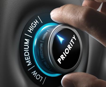 Foto de Man fingers setting priority button on highest position. Concept image for illustration of priorities management. - Imagen libre de derechos
