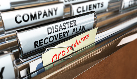 Foto de Close up on a file tab with the text Distaster Recovery Plan, focus on the main text and blur effect. Concept image for illustration of DRP ans crisis communication. - Imagen libre de derechos