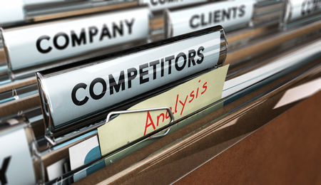 Foto de Close up on a file tab with the word competitors, focus on a yellow, note where it is hanwritten analysis, blur effect. Concept image for illustration of strategic management or business intelligence. - Imagen libre de derechos