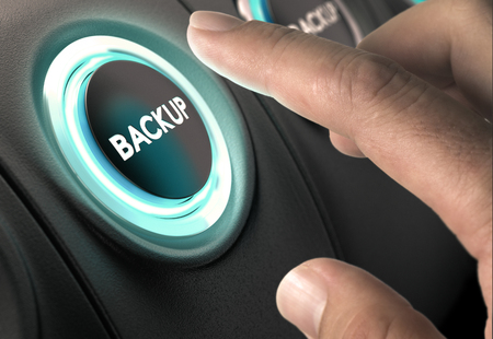 Foto de Finger about to press circular button with blue light over black background. Concept of data backup and secure online back-up. - Imagen libre de derechos
