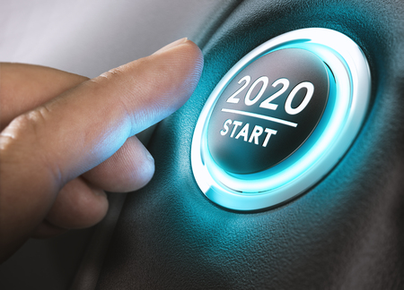 Foto de Finger about to press a car ignition button with the text 2020 start. Year two thousand and twenty concept. - Imagen libre de derechos
