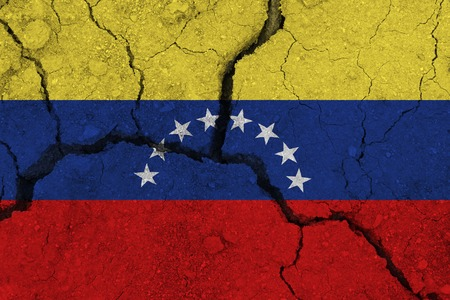 Photo pour Venezuela flag on the cracked earth. National flag of Venezuela. Earthquake or drought concept - image libre de droit