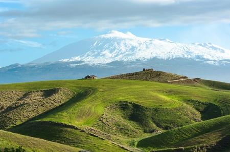 Photo pour the majestic Etna dominates the rolling hills of the hinterland of Sicily - image libre de droit