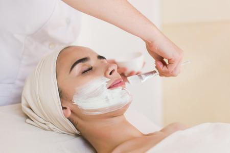 Foto de Woman with facial clay mask. - Imagen libre de derechos