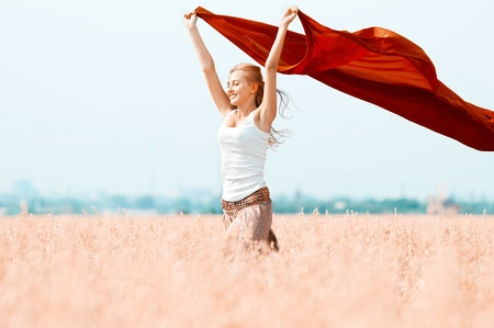Photo pour Young happy woman in wheat field with fabric. Summer picnic - image libre de droit