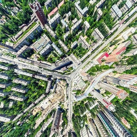 Foto de Aerial city view with crossroads and roads, houses, buildings, parks and parking lots. Sunny summer panoramic image - Imagen libre de derechos