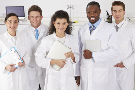 Photo for Portrait Of Laboratory Technicians Standing In Group - Royalty Free Image