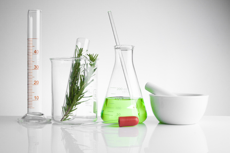 Foto de herbal medicine natural organic and scientific glassware, Research and development concept. - Imagen libre de derechos