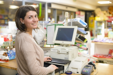 Photo for Young woman at cash register in a store - Royalty Free Image