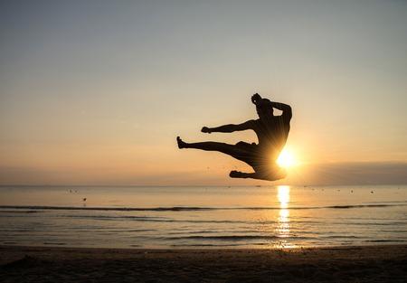 Martial arts master at sunrise