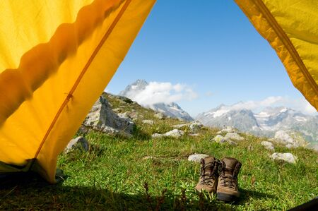 hiking concept shoes and tent