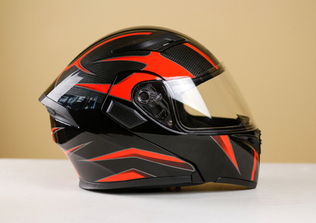Foto de Beautiful black with red motorcycle helmet. With a transparent visor. Closeup. Isolated. - Imagen libre de derechos