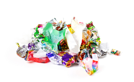 Photo for A bunch of candy wrappers on a white background. Closeup. - Royalty Free Image