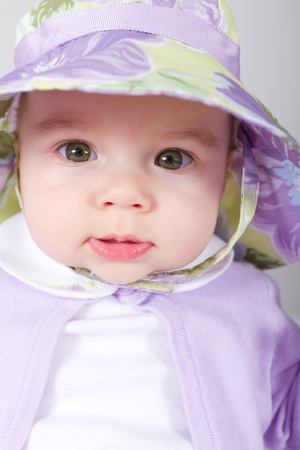 Photo for 5 Months old Baby giving tranquil look in to lens with her complimenting clothing - Royalty Free Image