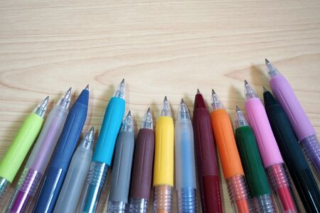 Photo for many color Ballpoint Pens on wooden table background - Royalty Free Image