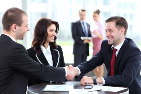 Photo for Business people shaking hands, finishing up a meeting - Royalty Free Image