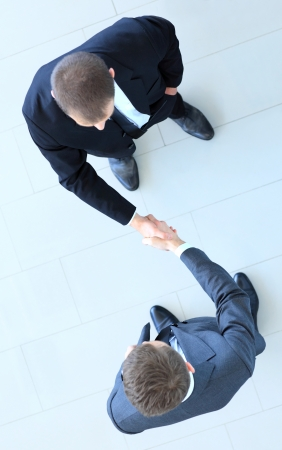 Photo for Top view of a two businessman shaking hands - Welcome to business - Royalty Free Image