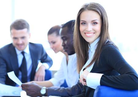 Foto de Face of beautiful woman on the background of business people - Imagen libre de derechos