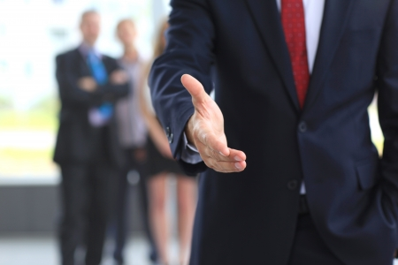 Photo pour A business man with an open hand ready to seal a deal - image libre de droit