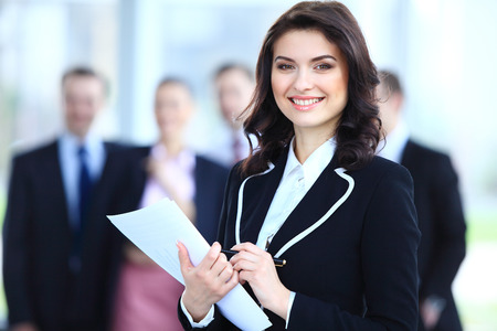 Photo pour Face of beautiful woman on the background of business people  - image libre de droit