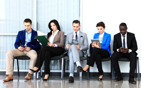 Photo pour Business people waiting for job interview  Five candidates competing for one position  - image libre de droit