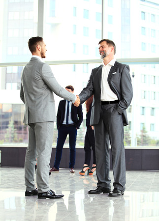 Photo for Business handshake. Handshake of two business men closing a deal at the office - Royalty Free Image
