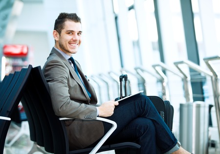 Photo for modern businessman using tablet computer at airport - Royalty Free Image