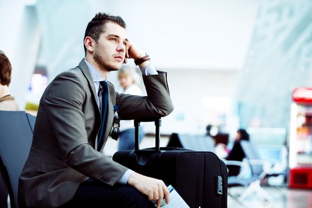 Foto de modern businessman using tablet computer at airport - Imagen libre de derechos