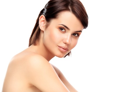 Photo pour Beautiful Face of Young Woman with Clean Fresh Skin close up isolated on white. Beauty Portrait. Beautiful Spa Woman Smiling. Perfect Fresh Skin. Pure Beauty Model. Youth and Skin Care Concept - image libre de droit