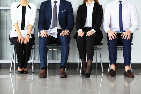 Photo for Business people waiting for job interview. Four candidates competing for one position - Royalty Free Image