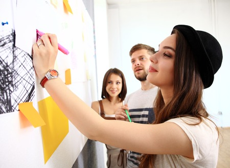 Foto de business, people, teamwork and planning concept - smiling business team with marker and stickers working in office - Imagen libre de derechos