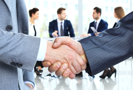 Foto de Closeup of a business handshake. Business people shaking hands, finishing up a meeting - Imagen libre de derechos