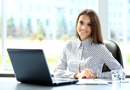 Photo for Business woman working on laptop computer at office - Royalty Free Image