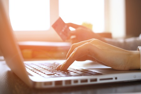 Photo pour Close Up Of woman Shopping Online Using Laptop With Credit Card - image libre de droit