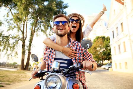 Photo pour Couple in love riding a motorbike - image libre de droit
