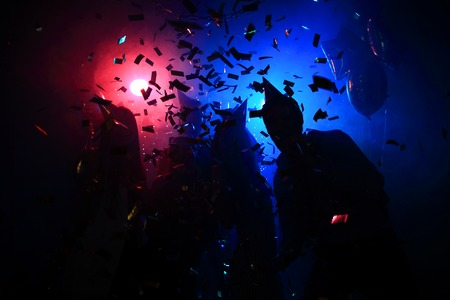 Photo pour Young happy people are dancing in club. Nightlife and disco concept - image libre de droit