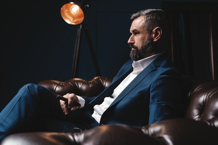 Photo for Attractive man with cigar and a glass whiskey - Royalty Free Image