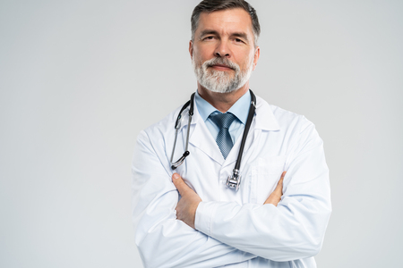 Photo for Cheerful mature doctor posing and smiling at camera, healthcare and medicine. - Royalty Free Image