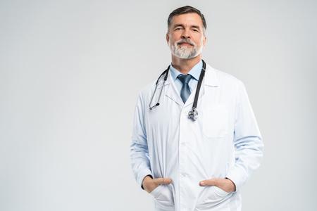 Foto de Cheerful mature doctor posing and smiling at camera, healthcare and medicine. - Imagen libre de derechos