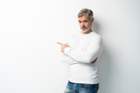Foto de Handsome middle age senior man presenting and pointing with palm of hand looking at the camera over white background. - Imagen libre de derechos