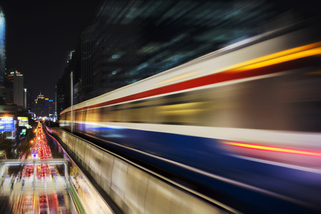 Photo for Speed motion Blur from Sky Train at night in modern city (background) - Royalty Free Image