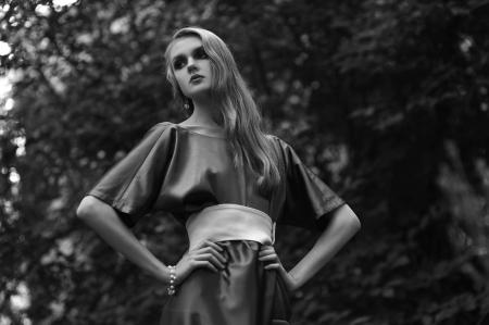 Retro woman in long dress in park