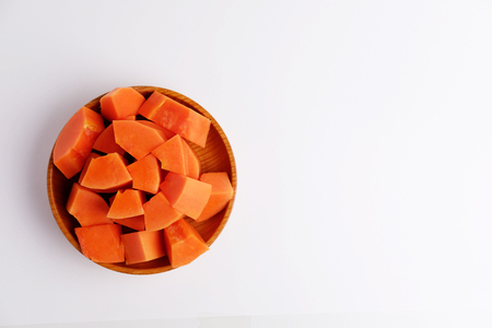 Photo for Top view of sweet papaya slices in wood plate on gray background. Blank space and selective focus. - Royalty Free Image