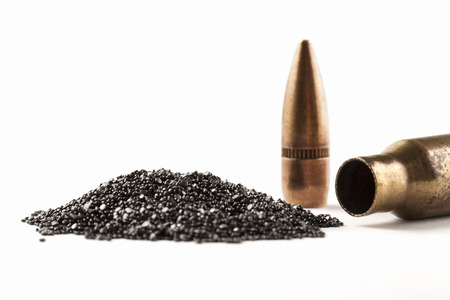 Photo pour Rifle Bullet and Shel near pile of gunpowder isolated on white - image libre de droit