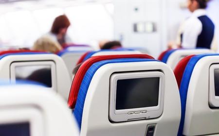 Foto de Row of seats with monitors inside of aircraft - Imagen libre de derechos