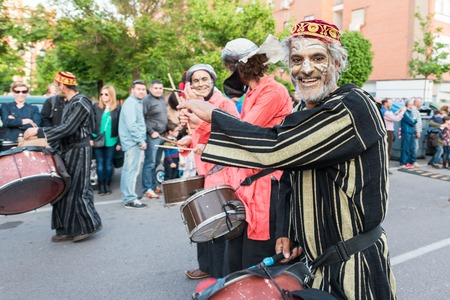 Painted and disguised musicians during the celebration of the feast of Saint George and the dragon.